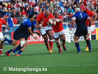 Tonga charging through the French defenders